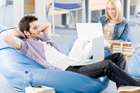 Students at high school or university relaxing with laptop studying Stock Photo - 9682455
