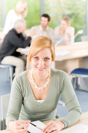 Young business students having meeting - businesswoman in front Stock Photo - 9682586