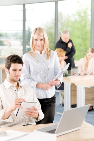 Portrait of young student businesspeople in office having meeting photo