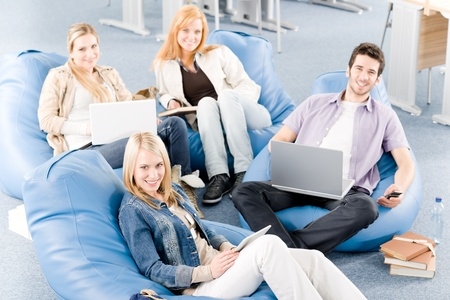 Group of young high-school or university students  learning and relaxing Stock Photo - 9682474