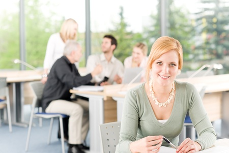 Young business students having meeting - businesswoman in front