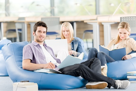 Group of students learning at high school relaxing with books Stock Photo - 9682495