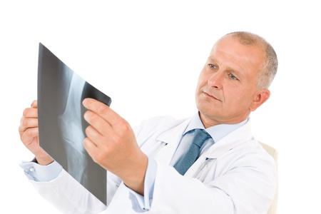 Portrait of hospital professional doctor hold and look at x-ray photo