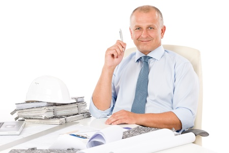 Portrait of professional architect with blueprints sitting behind table Stock Photo - 9682699
