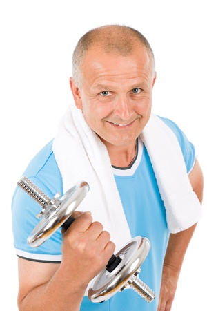 Portrait of happy fit mature man working out with dumbbells Stock Photo - 9682612