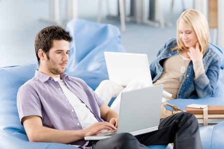 Students at high school or university working on laptop studying Stock Photo - 9682523