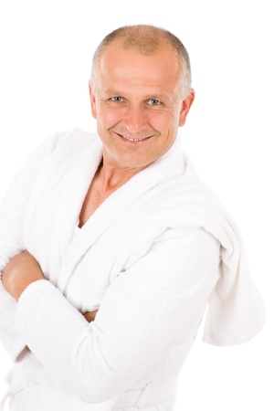 Portrait of mature man wear bathrobe hold towel isolated photo