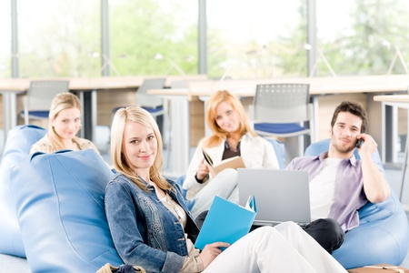 Group of young high-school or university students  learning and relaxing photo