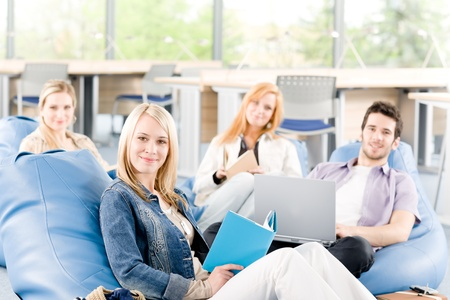 Portrait of high-school study group with laptop sitting together Stock Photo - 9682538