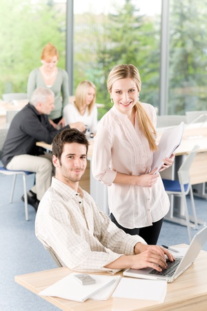 Business office team meeting businessman working on laptop with assistant Stock Photo - 9753924