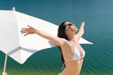 Portrait of happy woman in white bikini bra on sunny day photo