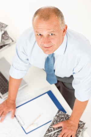 Closeup of senior man working on paperwork at his office table Stock Photo - 9753986