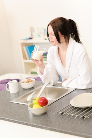 Student apartment - young student girl drink milk for breakfast Stock Photo - 9754675