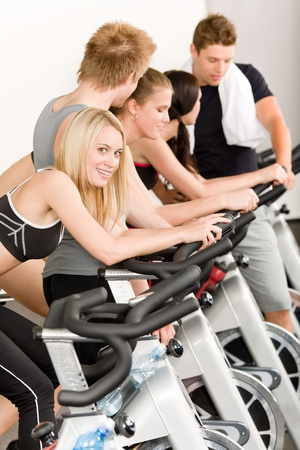 Fitness group of people on bicycle doing spinning at gym Stock Photo - 9825033