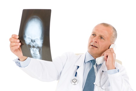 Hospital professional doctor male with stethoscope on phone hold x-ray photo