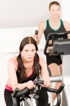 crosstrainer: Fitness young girl on gym bike - crosstrainer in background Stock Photo