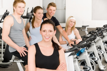 Fitness young group people at gym bicycle portrait Stock Photo - 9824791
