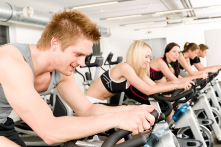 Fitness group of people on bicycle doing spinning at gym Stock Photo - 9824796