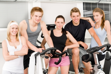 Fitness young group people at gym bicycle portrait Stock Photo - 9824810