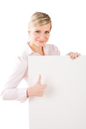 Happy businesswoman behind blank white banner thumbs up photo