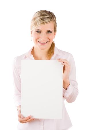 Happy businesswoman with blank advertising banner on white photo