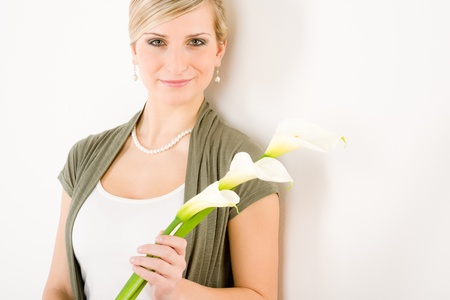 Romantic woman hold calla lily flower on white purity femininity photo