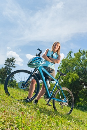 Sport mountain biking happy girl relax in meadows sunny countryside photo