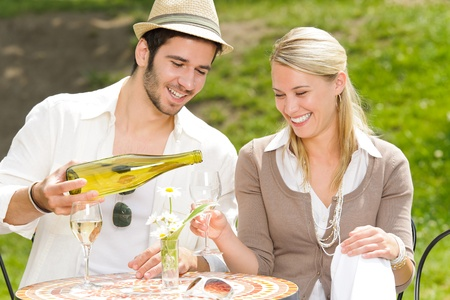 outdoor cafe: Italian restaurant terrace elegant couple celebrate drink wine summer day