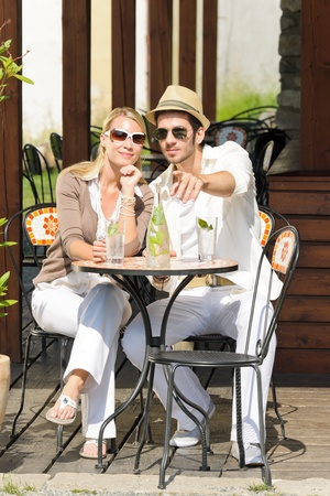 Italian restaurant terrace elegant couple sitting drink water summer day photo