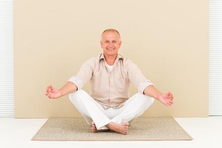 one senior adult man: Casual business yoga senior handsome businessman stress control lotus pose
