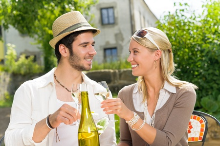 Italian restaurant terrace elegant couple celebrate drink wine summer day photo