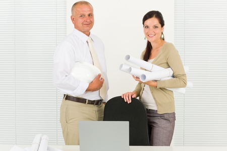 Professional architect people behind office table blueprints portrait photo