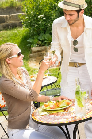 Italian elegant young people dining at outdoor restaurant terrace photo