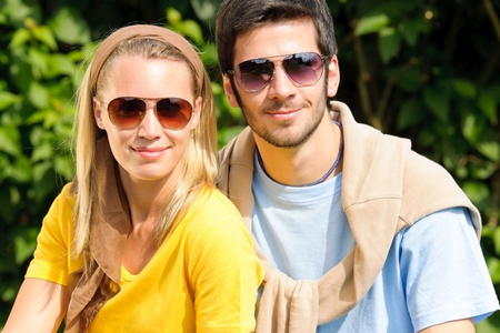 Sportive young couple portrait wear sunglasses outside sunny day photo
