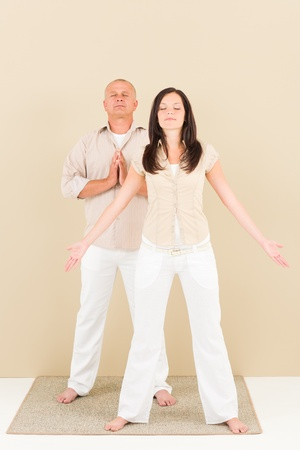 Casual business yoga pose businesspeople standing closed eyes photo