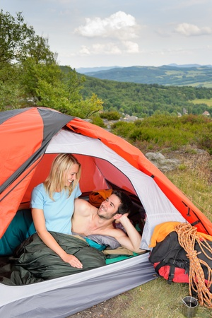 Camping young couple backpackers hugging in tent climbing gear sunset Stock Photo - 10082502