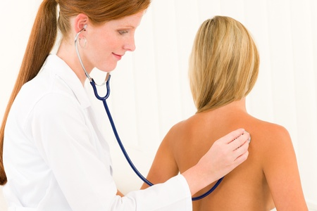 Medical professional doctor with stethoscope examine woman patient naked back Stock Photo - 10082647