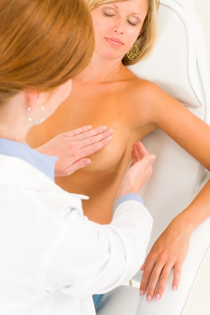 breast examination: Plastic surgery female doctor examine blond woman patient breast shape