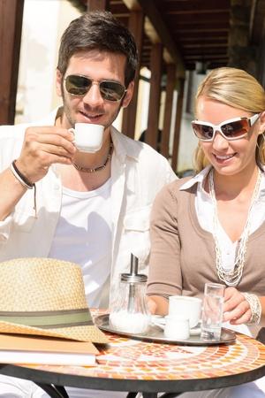 Italian restaurant terrace elegant couple sitting drink coffee summer day