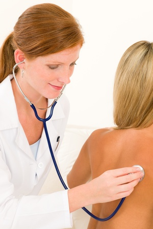Medical professional doctor with stethoscope examine woman patient naked back Stock Photo - 10082633