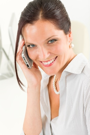 Professional businesswoman attractive calling close-up portrait photo