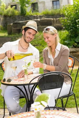 italian man: Italian restaurant terrace elegant couple celebrate drink wine summer day