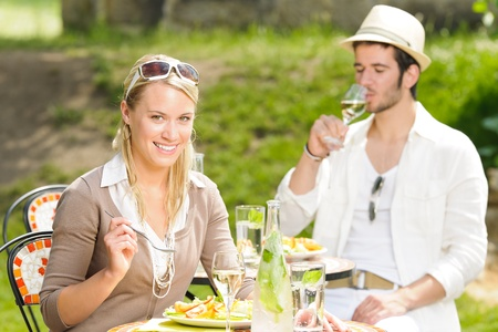 Italian elegant young couple dining at outdoor restaurant terrace