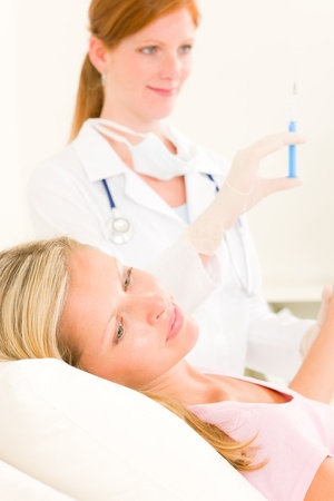 Female medical doctor apply injection woman patient Stock Photo - 10135000