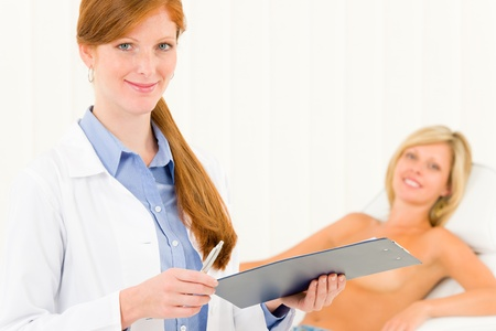 Plastic surgery female doctor examine blond woman patient breast shape Stock Photo - 10135006