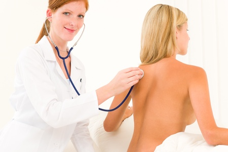 Medical professional doctor with stethoscope examine woman patient naked back Stock Photo - 10180237