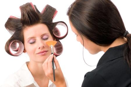 Make-up artist woman fashion model apply powder blush rouge brush photo