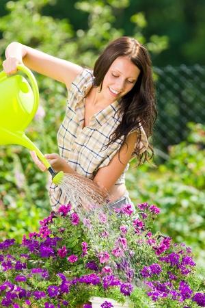 woman gardening: Summer garden beautiful romantic woman brunette care white flowers