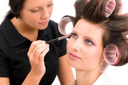 hair curler: Make-up artist woman fashion model apply eyeshadow with brush
