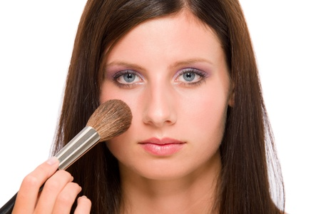 Make-up artist woman fashion model apply powder blush rouge brush photo